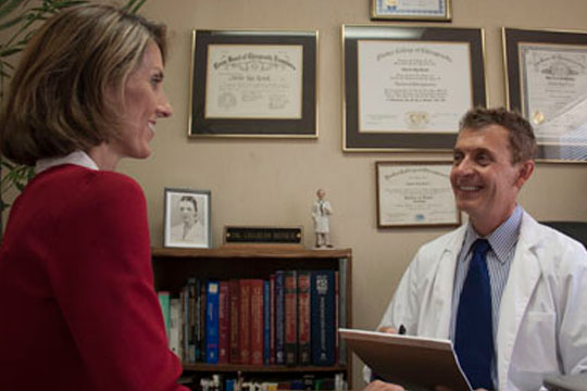 Chiropractor Columbia SC Charles Renick with Patient